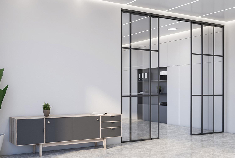 Glasschiebetüren im Industrial Design Milieu mit schwarzem Gitterdesign